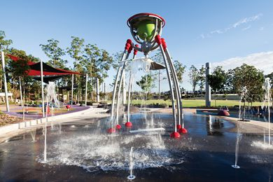 The waterpark, with its central waterfall, is a popular destination for children.
