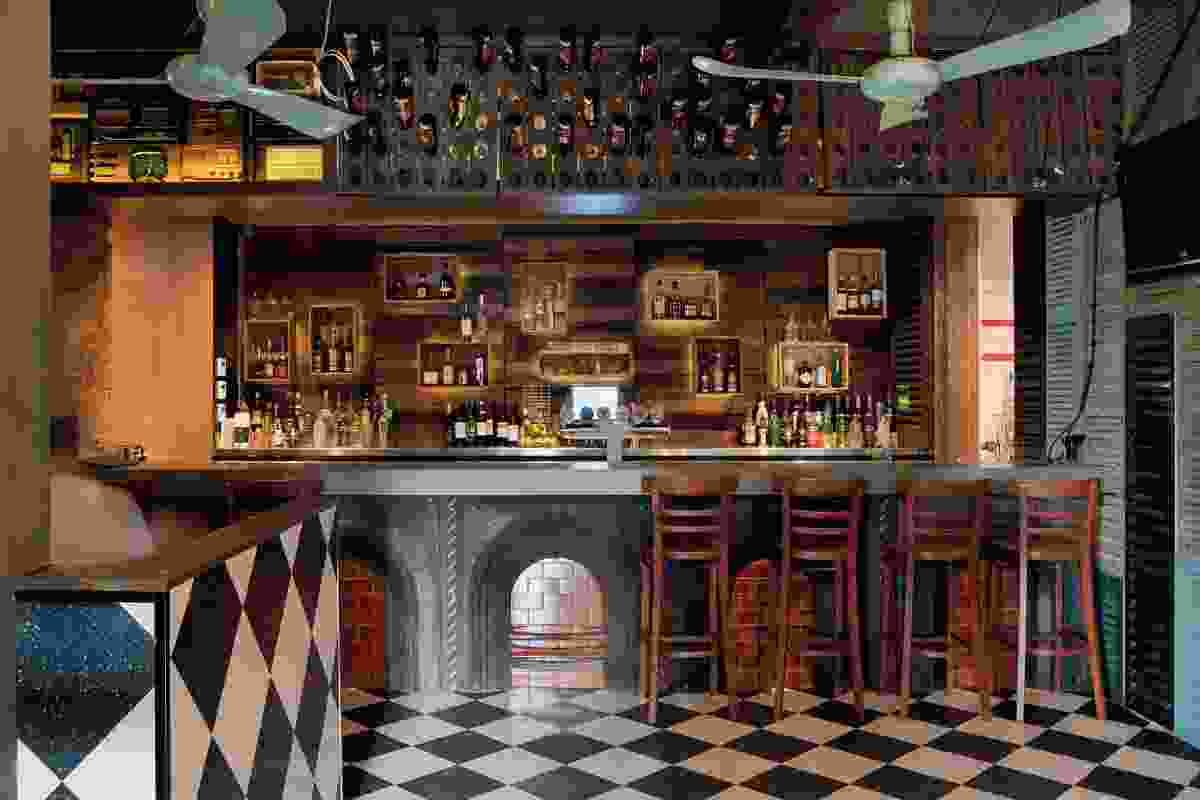 The bar front is made of old fireplaces.