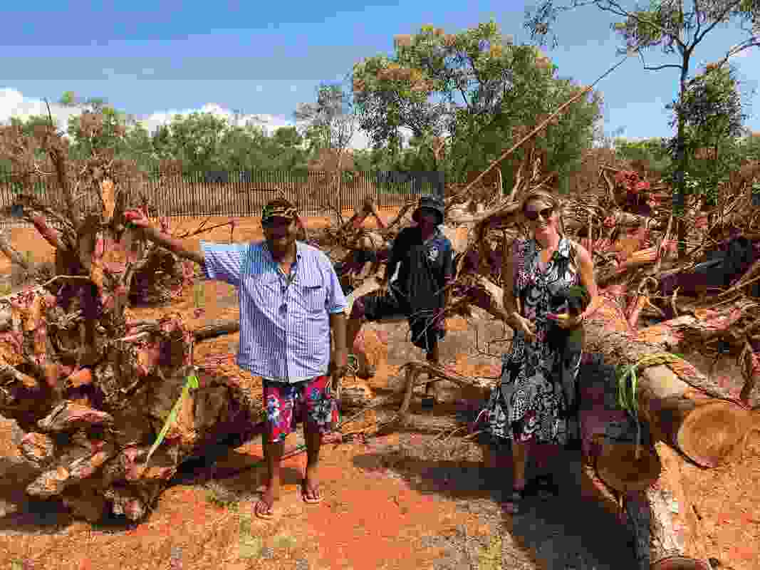 Arnold Smith, Jimmy Edgar and Vanessa Margetts selecting wood for the youth carving project at Town Beach, Broome.