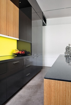 The palette of materials in the kitchen is varied in order to give texture and interest to the space.