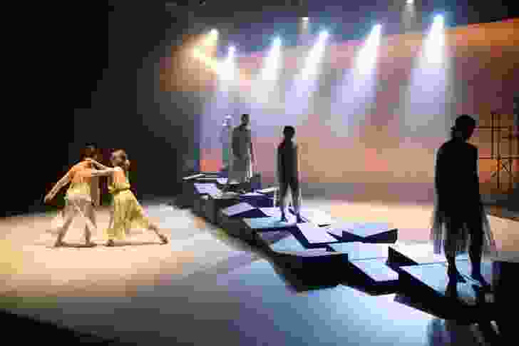 The dancers create various terrains with the modular components of the wall.
