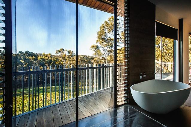 Upstairs bathroom: Viselio Life freestanding bath. Custom balcony balustrade in galvanized steel tubing at irregular intervals.