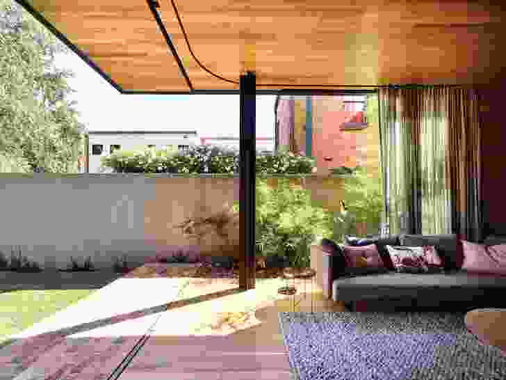 L-shaped sliding panels help extend the rear living spaces into the garden beyond.