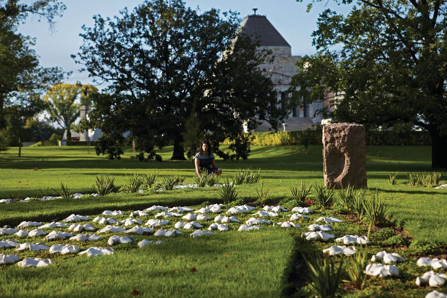 Katherine Rekaris in the garden she designed in memory of women who have served at war.