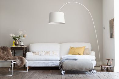A Twiggy Lamp from Foscarini overhangs the sofa creating a cosy but casual living space.