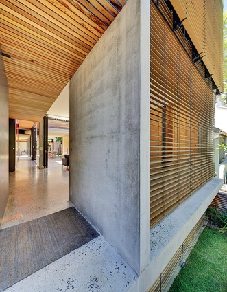 The axis set by the front door is followed rigorously through the long, linear house.