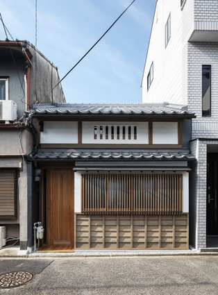 The front facade of the Kyoto Terrace House has been restored and includes traditional elements.