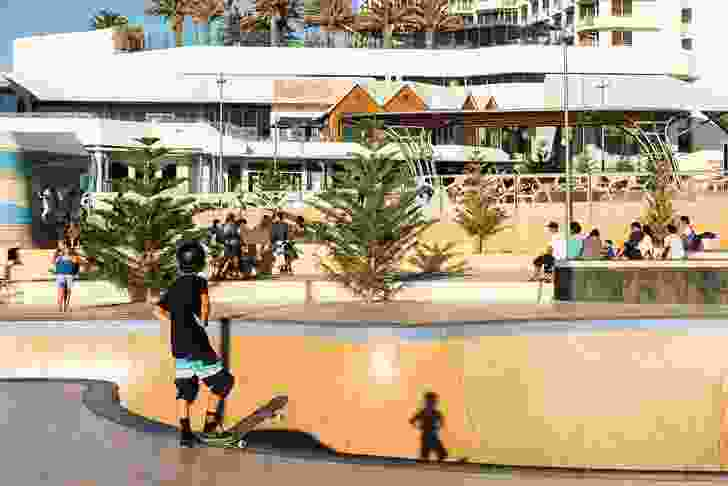 Skaters embrace the challenging terrain of the new skatepark and bouldering space, designed by Enlocus.