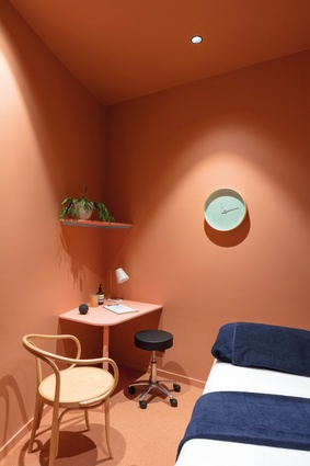 After researching the emotional associations inherent in particular colours, the designers used salmon pink and mint green for the treatment rooms.