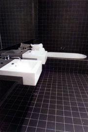 The sleek minimalism of an apartment bathroom.