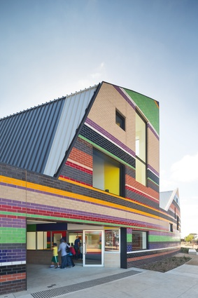 The colour and pattern used at Dallas Brooks Community Primary School (2013) was inspired by the traditional dress of local ethnic groups.