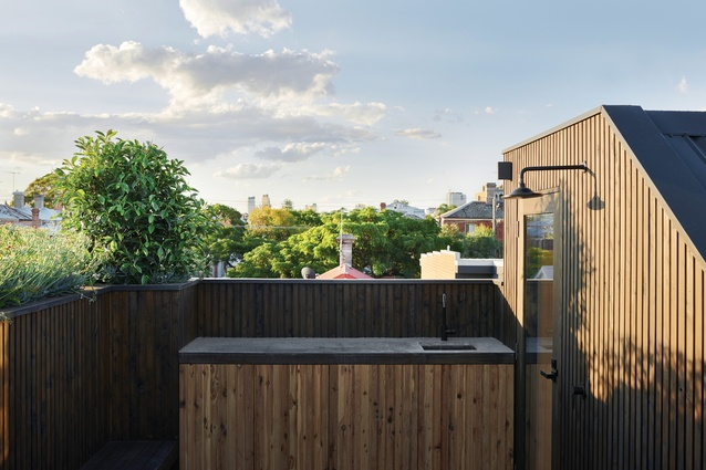 The roof terrace, on the third level, is a robust, timber-clad space that offers views to the city.
