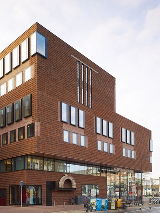 The Dutch bricks are suspended over glass and thin soffits.