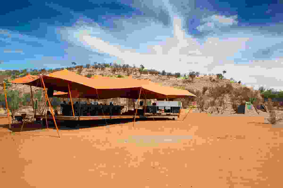 While the canopy shape was inspired by Bedouin tents, its colour melds with the baked red earth.