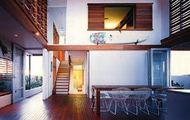 The connecting space of the breezeway. The window to the main bedroom is above a surfboard from Don O'Rorke's collection.Image: Brett Boardman