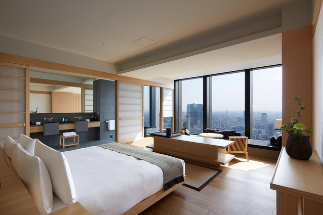 The guest bedrooms include elements of traditional Japanese design: Japanese sen timber wall panels, split level floors, shoji screens that conceal the bathroom, and a large granite tub.