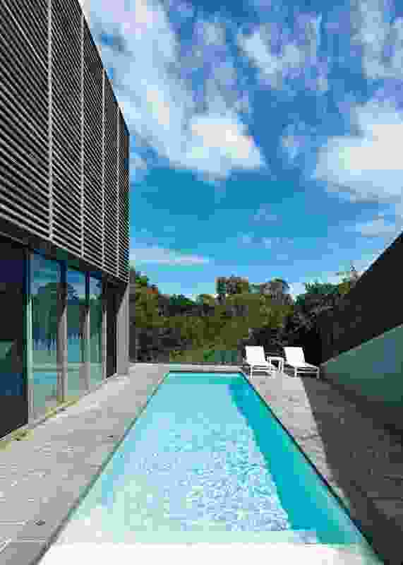 The sloped northern boundary shields the pool and deck.