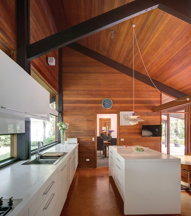 One of the few alterations made to the house by its current owner was to replace the all-wood kitchen with an open-plan, white-joinery arrangement.
