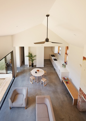 The living, dining and bedroom/ensuite skirt a long courtyard garden, allowing northern light into each new program.