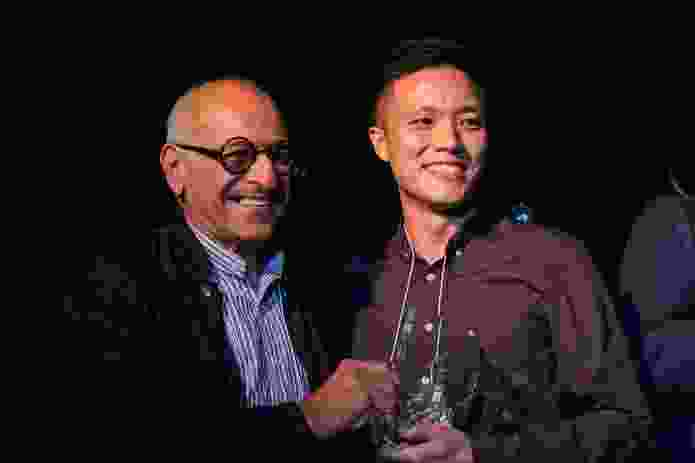 Architecture and Interior Design winner Michael Ong receiving his award from mentor Brian Zulaikha.