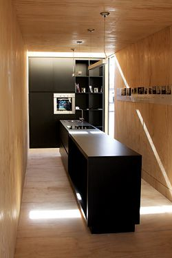 Interior of Room 11's MODV 2.0, a converted shipping container which is intended for living in.