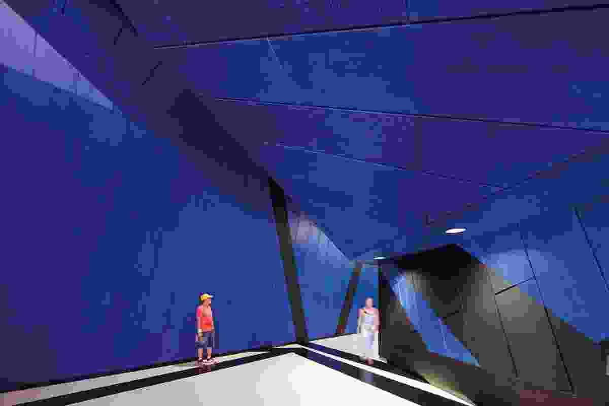 Inside the Perth Arena is a cosmic labyrinth of spatial delight. Klein blue is a signature colour.
