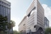 Candalepas Associates designs marble and scalloped-concrete tower