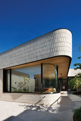 The curved rear facade of the Brick House, Clare Cousins's own home, delivers seventeen metres of frontage to the garden.