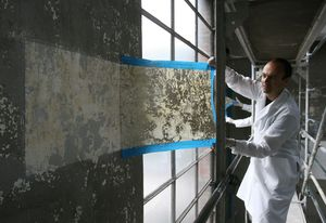 Jorge Otero-Pailos cleaning the wall of the Alumix factory in 2008.