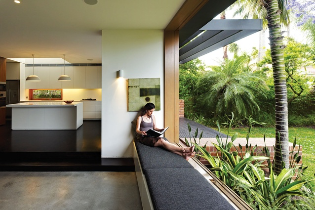 Bronte House living area extends into the garden with a built-in window seat.