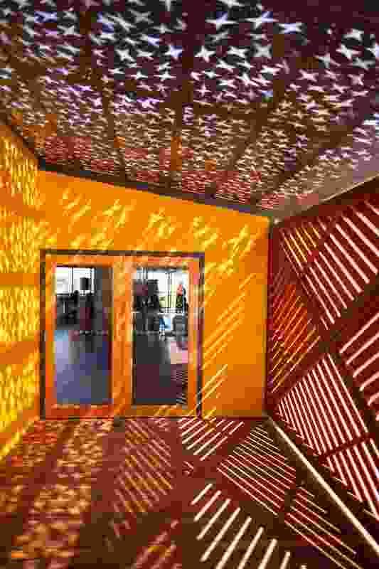 Laser-cut Corten steel panels on the balconies interpret Gulumbu Yunupingu's internationally famed work Garak, The Universe.