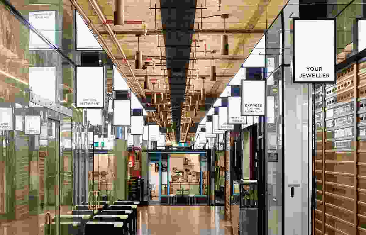 Strip lighting, illuminated signage and small mirrored bulkheads along the edges of the concrete ceiling offer modest sparkle to the previously dreary arcade.