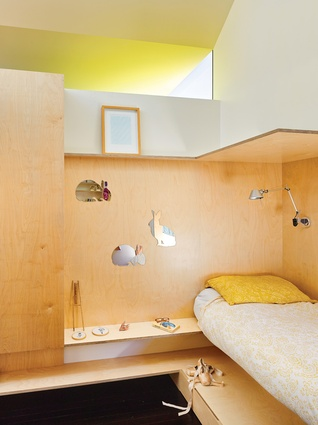 Mirrored surfaces and pale timber create a light, airy feel in this compact children's bedroom.