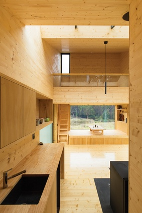 From the entry point, there is an inviting view to the light, honeyed timbers of the cocoon-like interior.