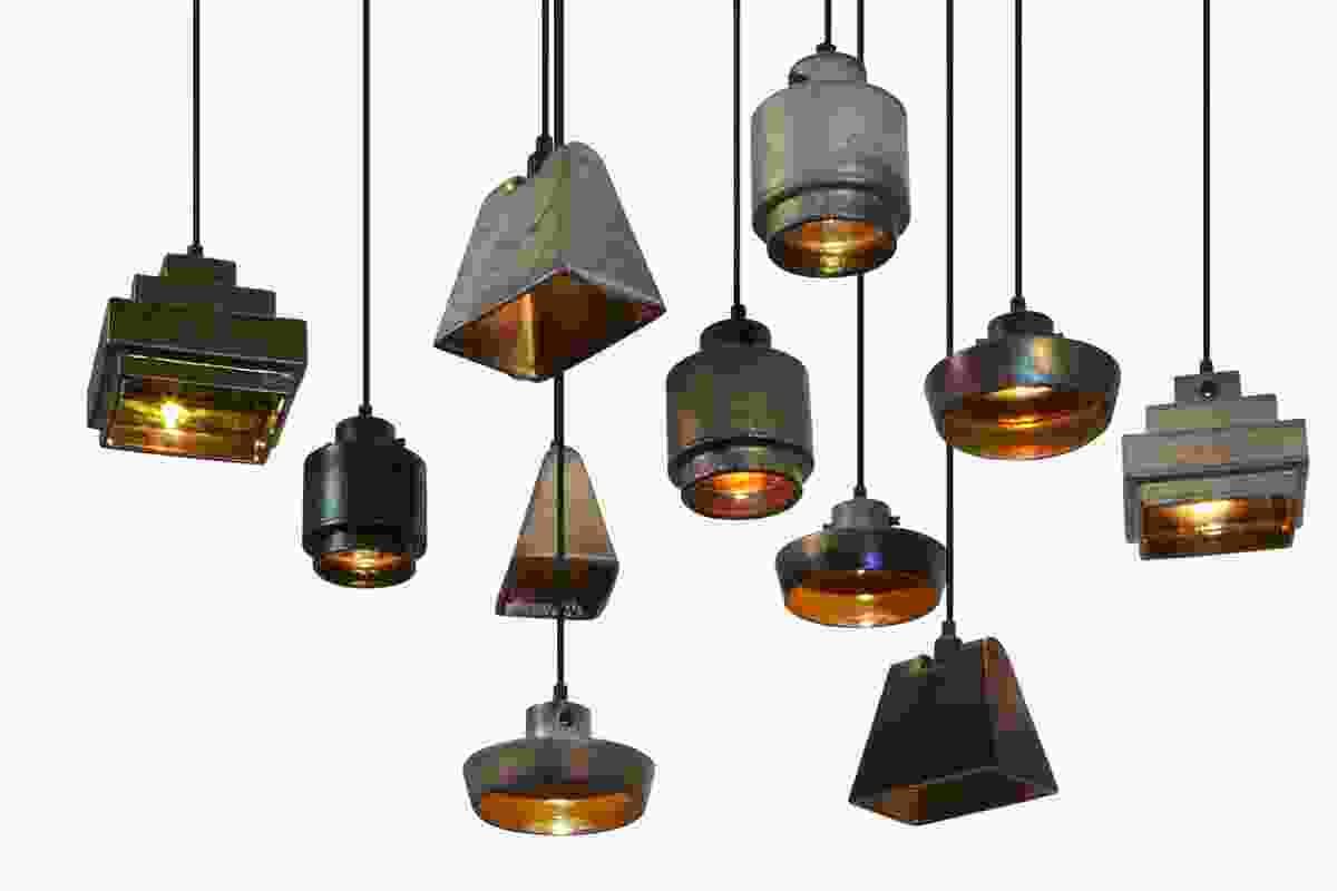 The Lustre series of handmade stoneware pendants with iridescent metallic finishes.