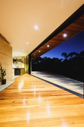 Living area open to the deck via nine metres of glazing.