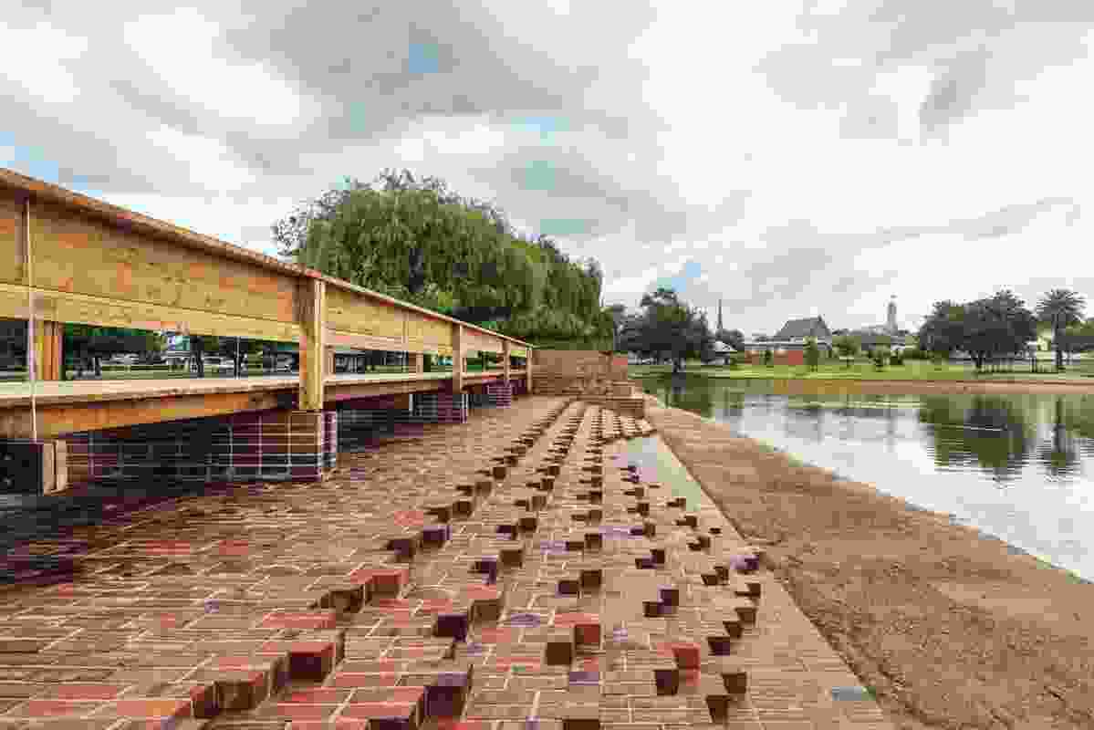 "The two brick spillways laid in complex horizontal ""steps"" beside Cato Lake in Stawell."