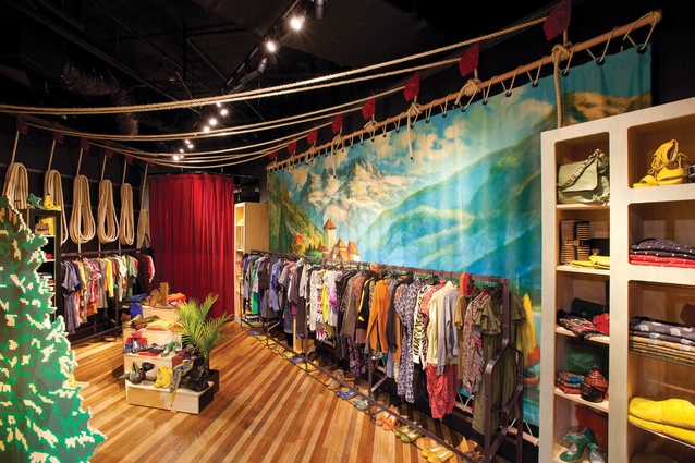 """Recycled oak floorboards form the rustic basis for the """"stage set"""" of the store."""