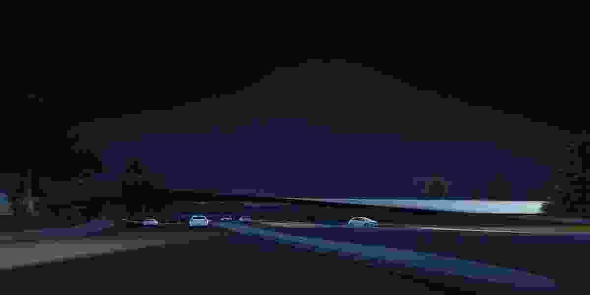The proposed Tasman Highway Memorial Bridge by Denton Corker Marshall at night.