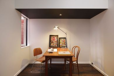 A study nook in the existing part of the house. Artworks: Wet Night, Haymarket and Harbour City by Ken Sterling.