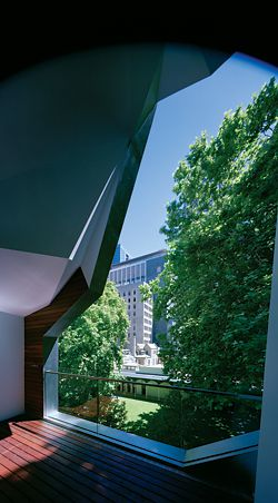 Looking from the cave-like balcony on the third level. The leafy view is of the mature landscape of the Melbourne Club.