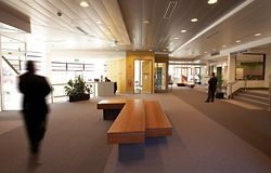 The foyer of the Collingwood Neighbourhood Justice Centre, with its recycled ironbark seating, is more akin to a community centre foyer than to a court building.