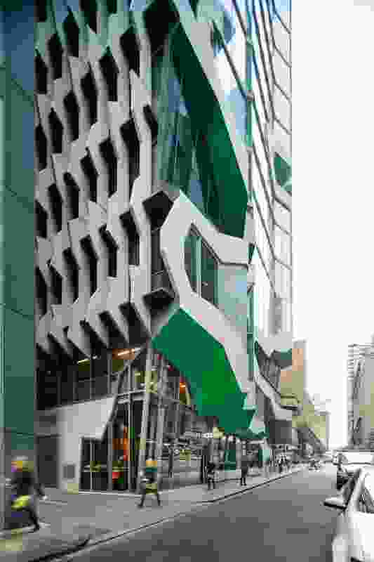Retail spaces tucked under the canopy on Flinders Lane ensure the building engages with the street.