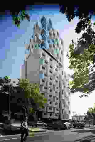 """Upper House, located on the corner of Swanston and Queensberry Streets in Carlton, Melbourne, comprises an eleven-storey podium element beneath a five-storey """"cloud"""" element."""