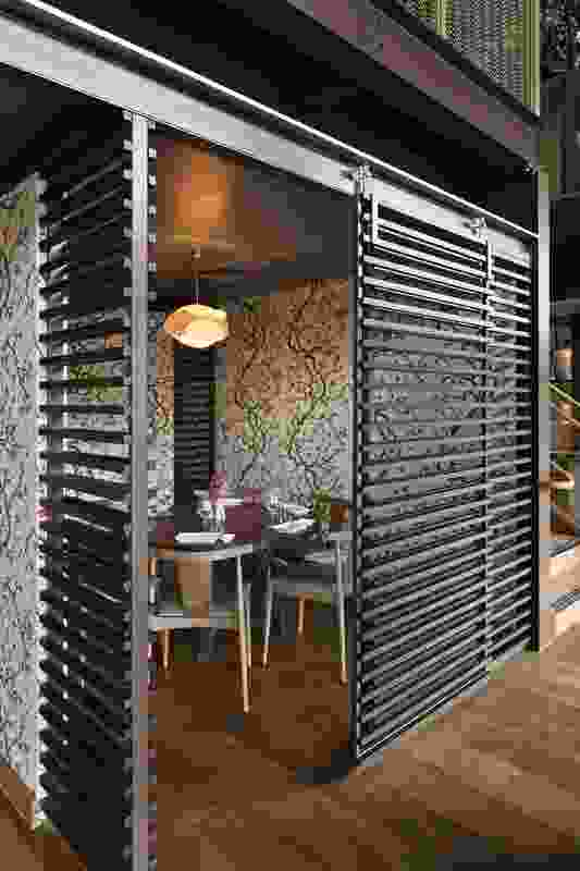 Timber screens delineate private dining areas.