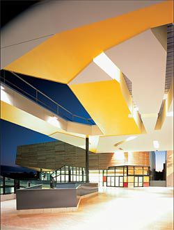 The atrium is penetrated by an opening to the sky and one to the lower level, allowing light to reach both levels.