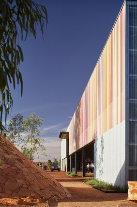 """With a nod to Learning from Las Vegas, a large barcode is painted on the exterior wall of the shed. When scanned, the lines of oranges and pinks say """"This is a Big Thing."""""""