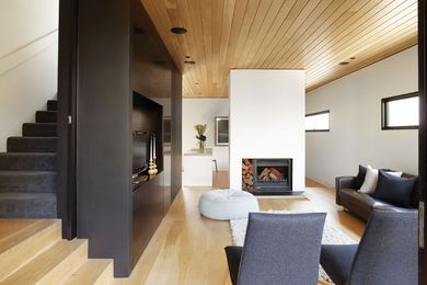 American oak flooring has been paired with ceiling lining boards that stretch from inside to out.