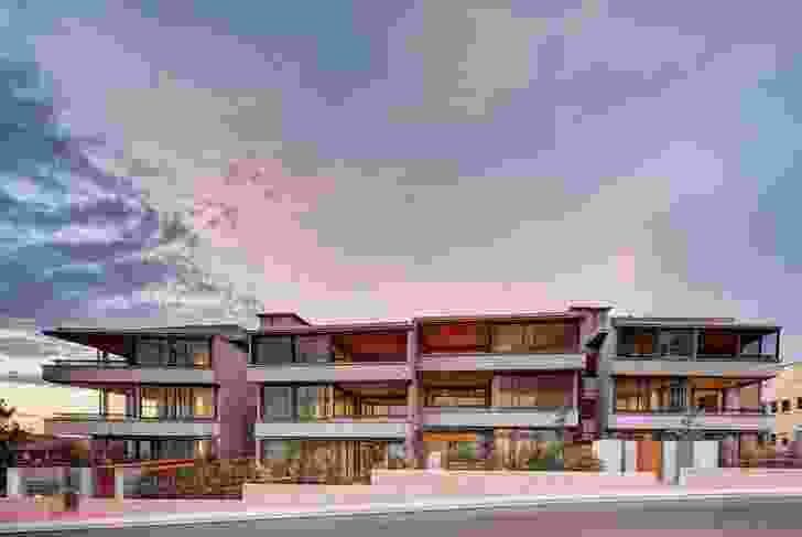 The building is a robust, horizontal presence overlooking the beach.