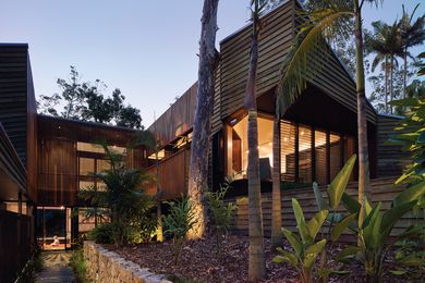 The U-shaped plan allows for an entry path navigating a courtyard chasm between the home's protruding wings.